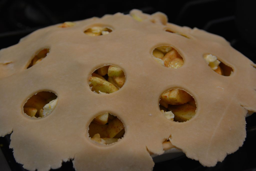 I cut out with a little jar polka dots to make the pie more decorative and cute. You can do any shape you want with cookie cutters or just put all of the dough over the top too!